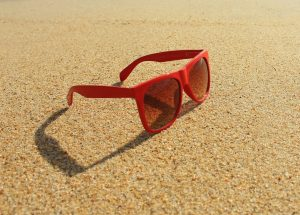 Red sunglasses on the beach